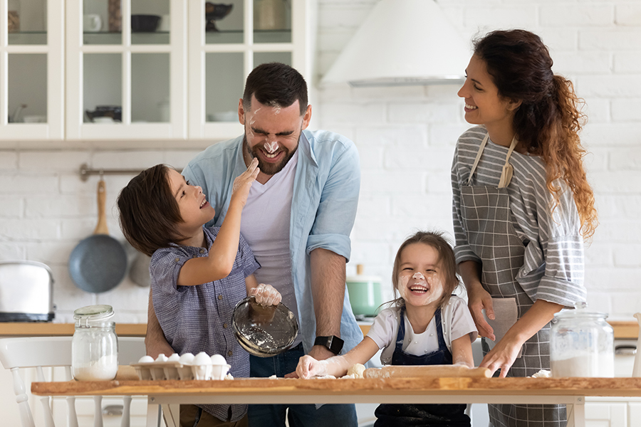 Personal Insurance - Overjoyed Parents with Kids Having Fun Cooking in the Kitchen